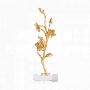 Fragment No. 19 On Stand by Aidan Gray is a tabletop sculpture of lively blossoms and an unfurling stem that rise from an acrylic base